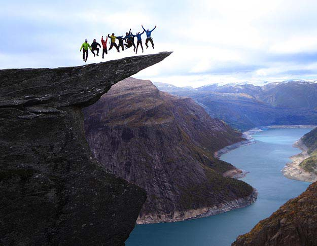 Jumping on the Trolltunga rock in Norway