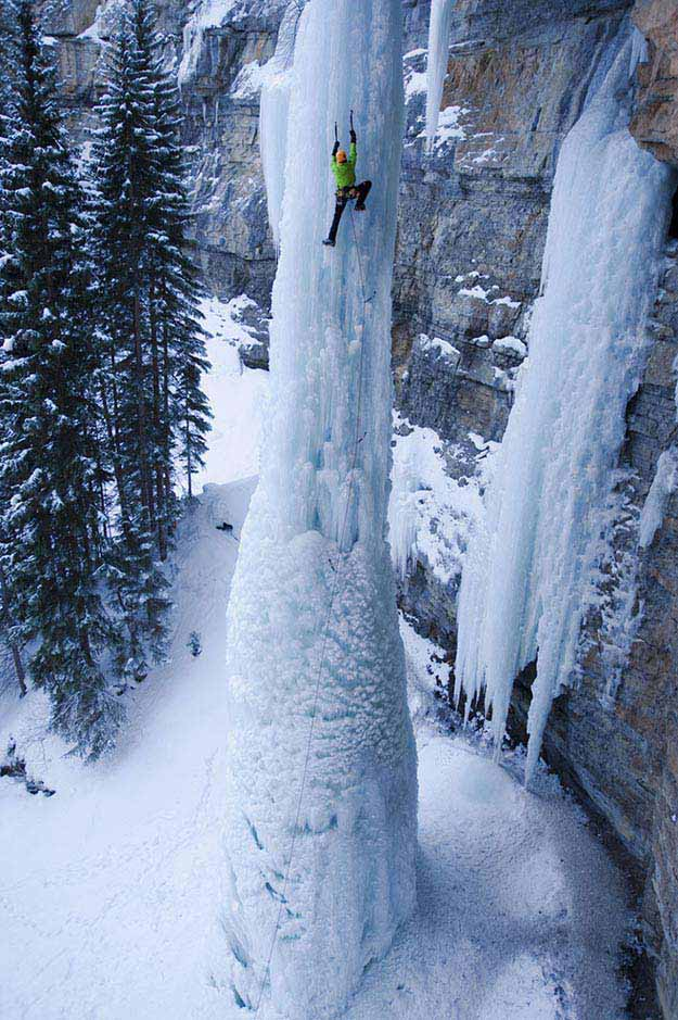 Ice climbing a frozen waterfall