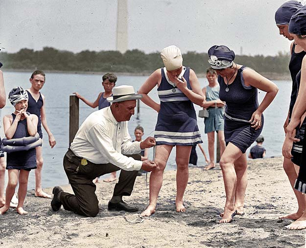 1922, the swimsuit police checking the length of a suit!