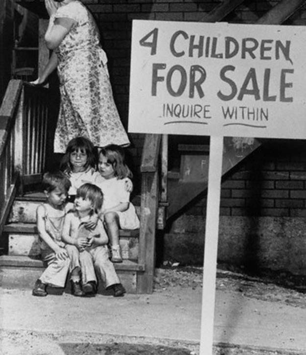 A penniless mother hides her face in shame after putting her children up for sale, Chicago, 1948