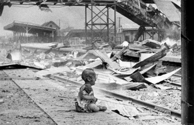 A baby cries at a bombed train station in Shanghai, 1937