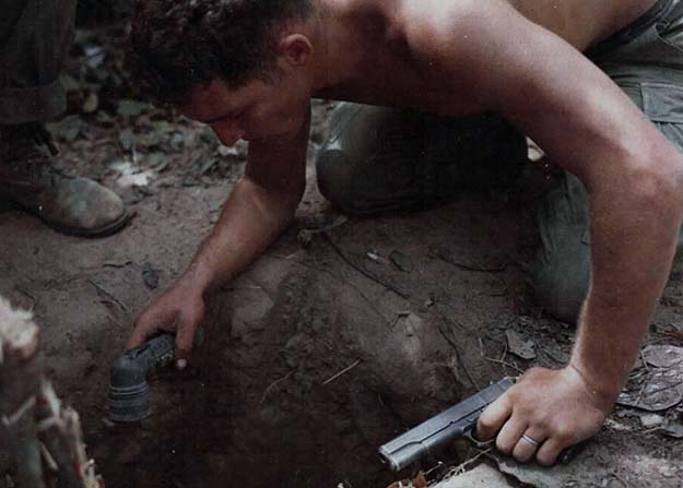 A US Marine prepares to enter a Vietcong tunnel, 1969