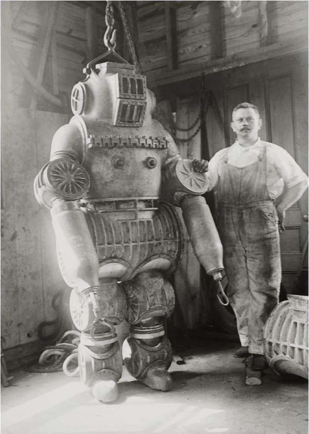 Chester E. Macduffee next to his newly patented, 250 kilo ping suit, 1911