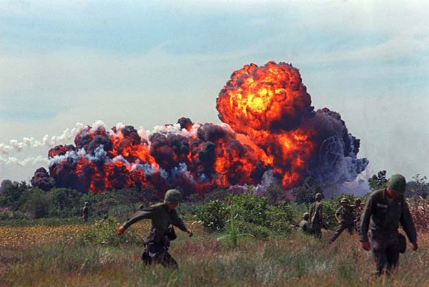 A napalm attack near U.S. troops on patrol in South Vietnam, circa 1966