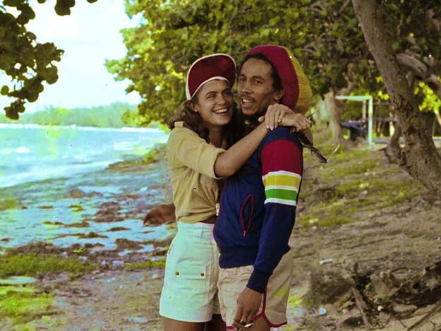 Bob Marley on the beach with Miss World 1976 Cindy Breakspeare, mother of Damien Marley