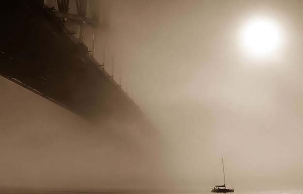 mist comes down and shrouds Sydney Harbour in Australia