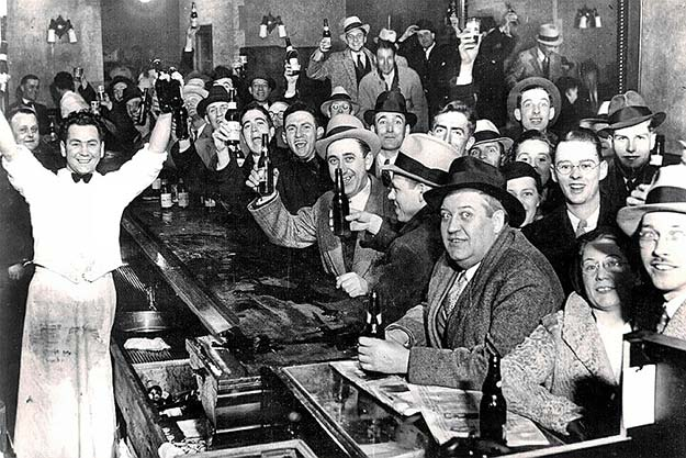 On this day, seventy-nine years ago, citizens in a bar celebrate the end of alcohol prohibition in the United States. December 5, 1933