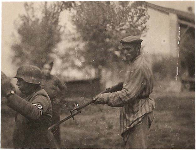 Liberated Jewish man holds NAZI soldier at gunpoint during WWII