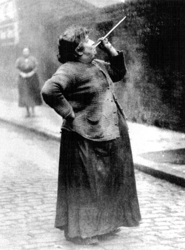 Before alarm clocks there were knocker-upper's. Mary Smith earned sixpence a week shooting dried peas at sleeping workers windows. Limehouse Fields. London