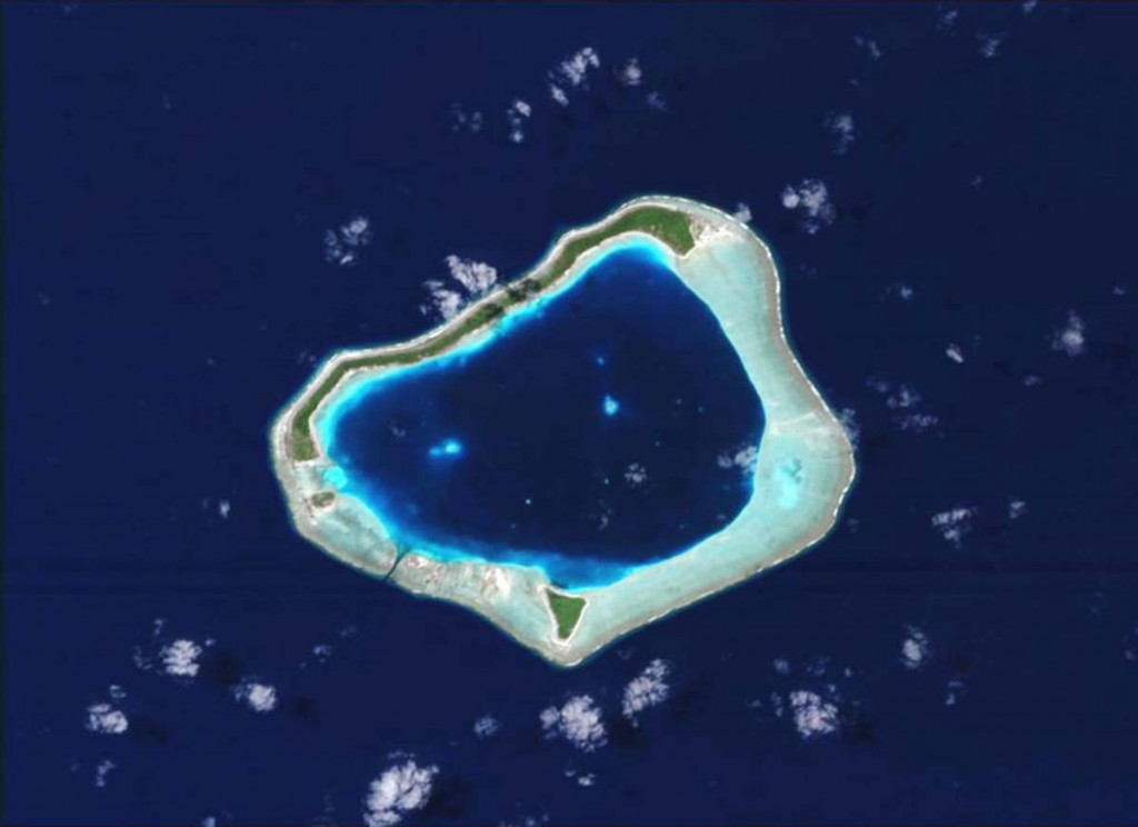 typical atoll belonging to the Society Islands, part of the overseas territory of French Polynesia. The atoll is made of a deep central lagoon surrounded by submerged reefs