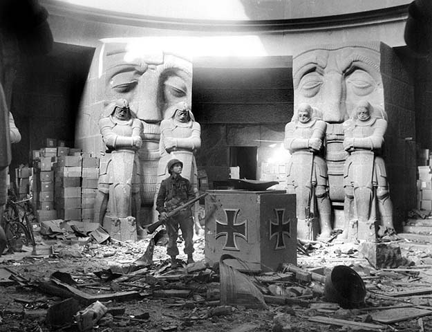 American soldier standing in the rubble of The Mounument to the Battle of the Nations near Leipzig Germany, 1945