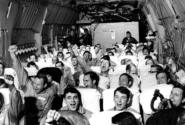 Newly freed prisoners of war celebrate as their C-141A aircraft lifts off from Hanoi, North Vietnam, on Feb. 12, 1973, during Operation Homecoming
