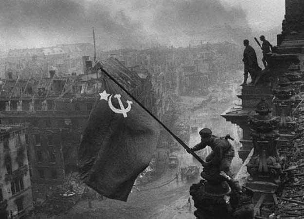 Raising a flag over the Reichstag, 1945