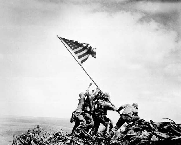 Raising the Flag on Iwo Jima, 1945 Read more at http://all-that-is-interesting.com/the-ten-most-iconic-photos-of-the-1940s/3/#pMPHCr4RAvexTf5x.99