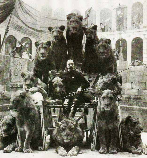 Animal Tamer Captain Jack Bonavita sitting down with some of his cats, ~1870s