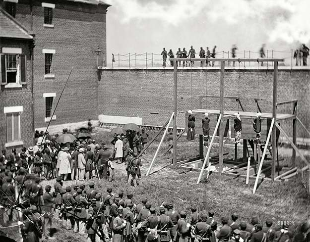 1865: Hanging hooded bodies of the four Lincoln assassination conspirators