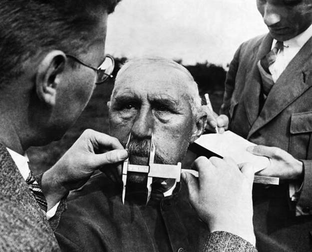 A man having his nose measured during Aryan race determination tests, 1940