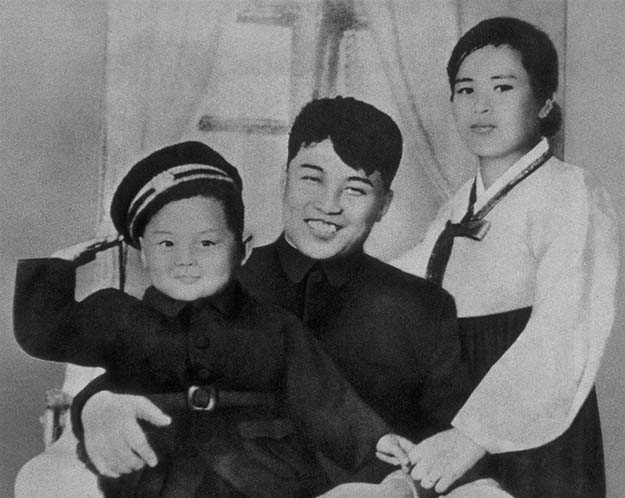 Kim Jong Il with his mother and father