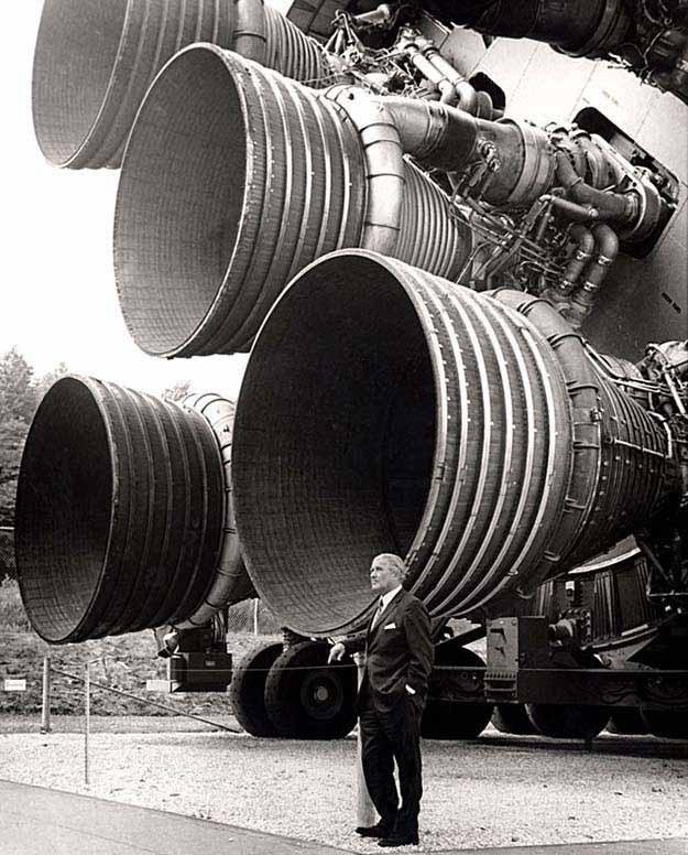 Dr. von Braun stands by the five F-1 engines of the Saturn V