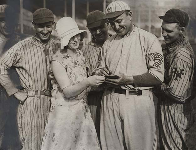 Ty Cobb signing an autograph while on a baseball tour in England, 1929