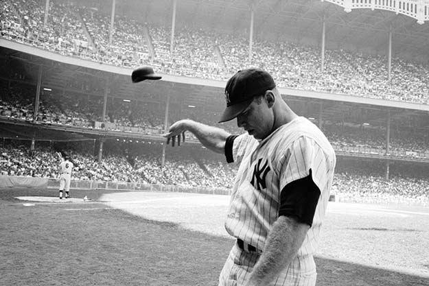 Mickey Mantle flings his batting helmet in disgust after a lousy at-bat, Yankee Stadium, 1965