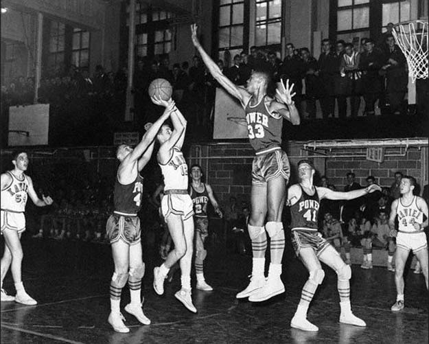Lew Alcindor blocking a shot during a high school basketball game. 1964