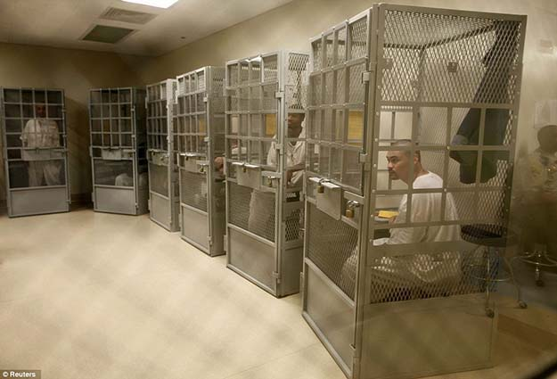 Caged therapy: Administrative segregation prisoners take part in a group therapy session at San Quentin