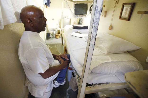 Jimmy Merjil, 70, who said he was serving life under the three strikes law for petty theft, sits in his cell at San Quentin state prison.