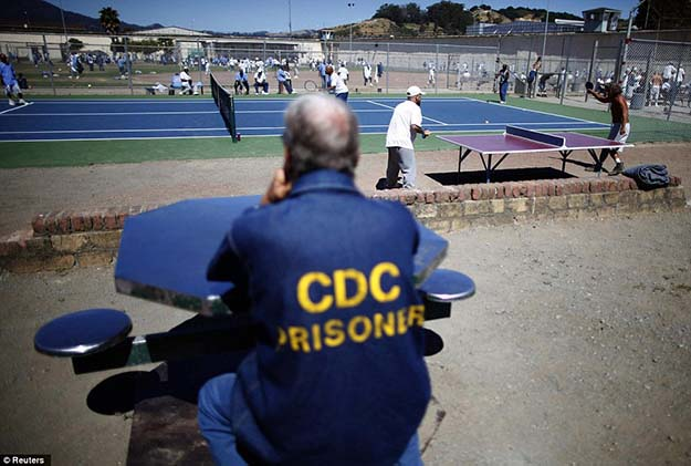 Pastime: Prisoners play table tennis in the exercise yard
