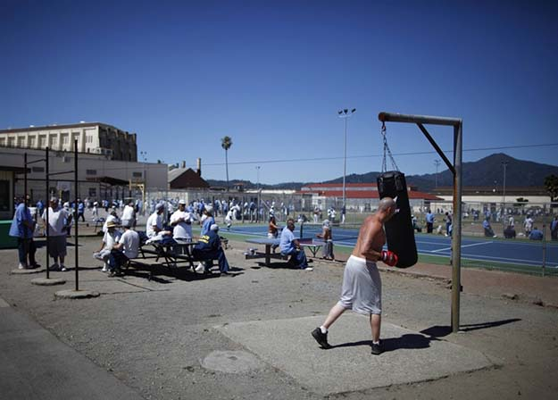 Chris Willis, 34, works out in the exercise yard at San Quentin state prison on June 8, 2012.
