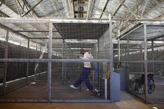 An administrative segregation prisoner exercises at San Quentin state prison