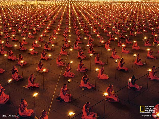 1000s Upon 1000s of Buddhist Monks Kneeling In Meditation