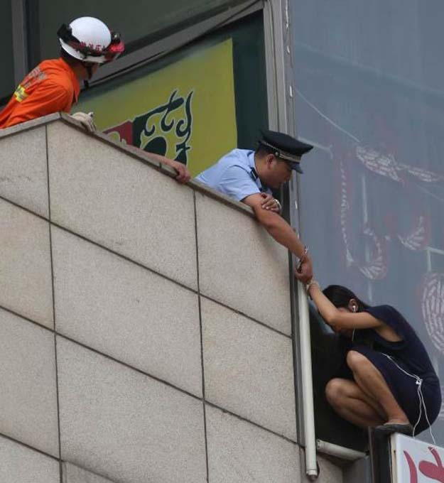 Beijing Cop Handcuffs Himself To Suicidal Woman On Ledge To Save Her Life