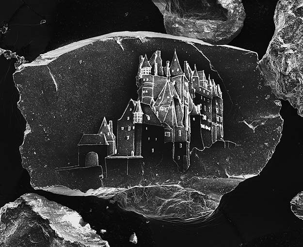 World's Smallest Sandcastle, Etched on a Single Grain of Sand