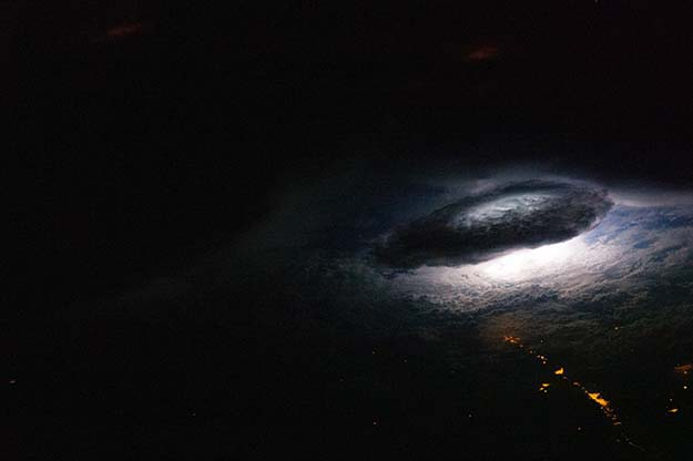 This is what a nighttime thunderstorm looks like from space