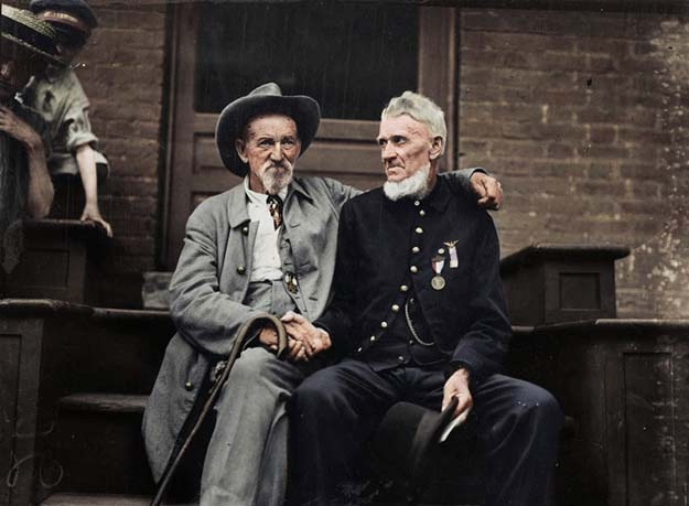 Civil War veterans at Gettysburg anniversary: A Union veteran and a Confederate veteran shake hands at the Assembly Tent, 1913