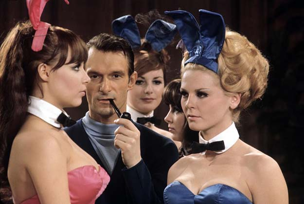 Hugh Hefner evaluating some new talent