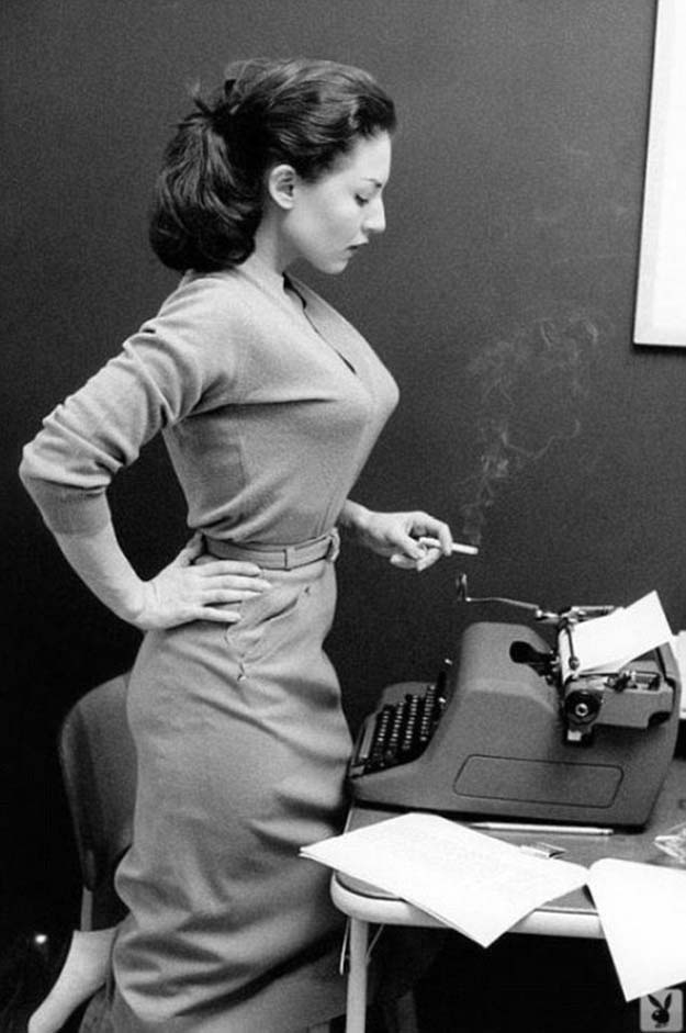 Girl with typewriter and a smoke