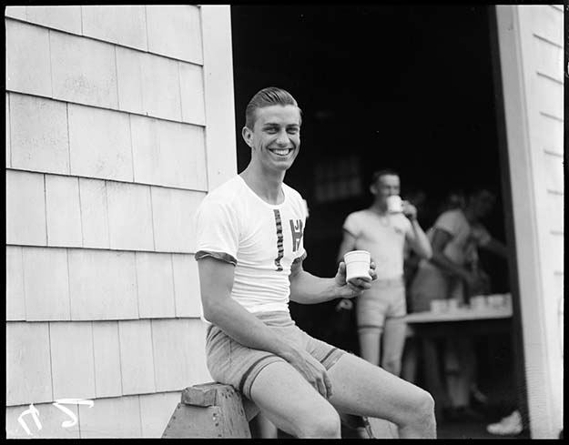 Franklin D. Roosevelt Jr. taking a break after rowing with Harvard crew