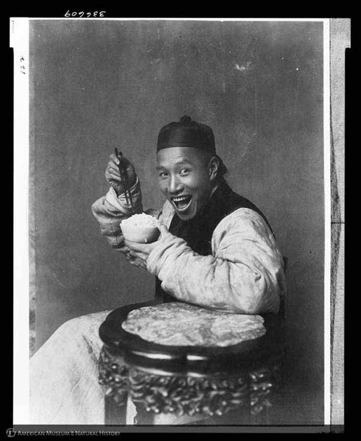 Man eating rice, China, 1901-1904
