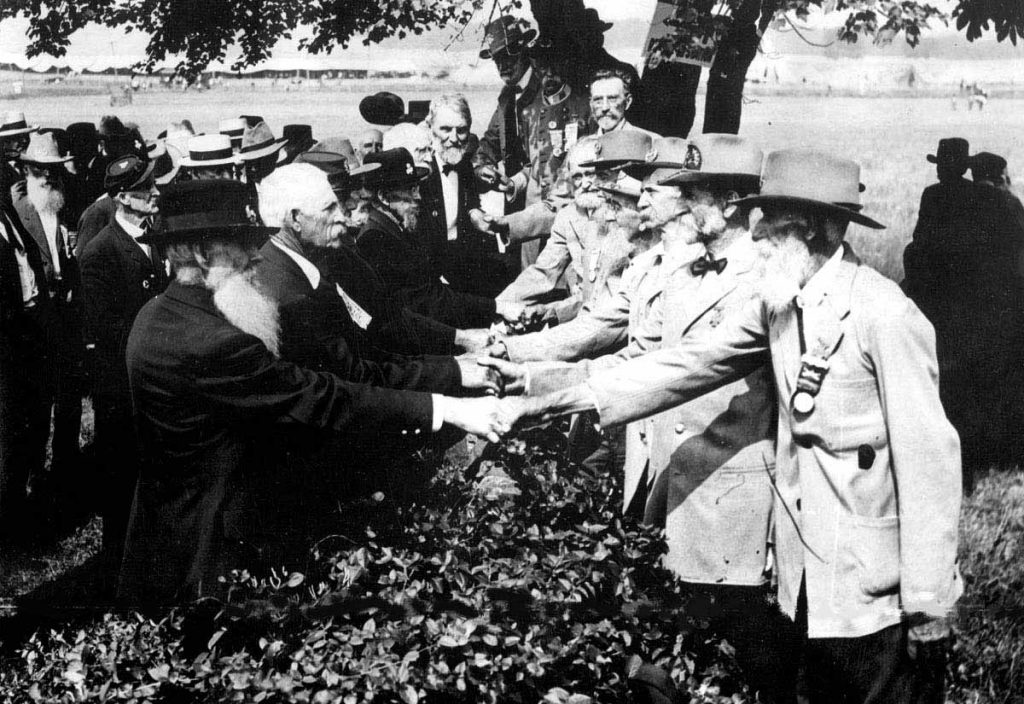 At the 50th anniversary of the battle of Gettysburg, Union and Confederate veterans shake hands. 1913