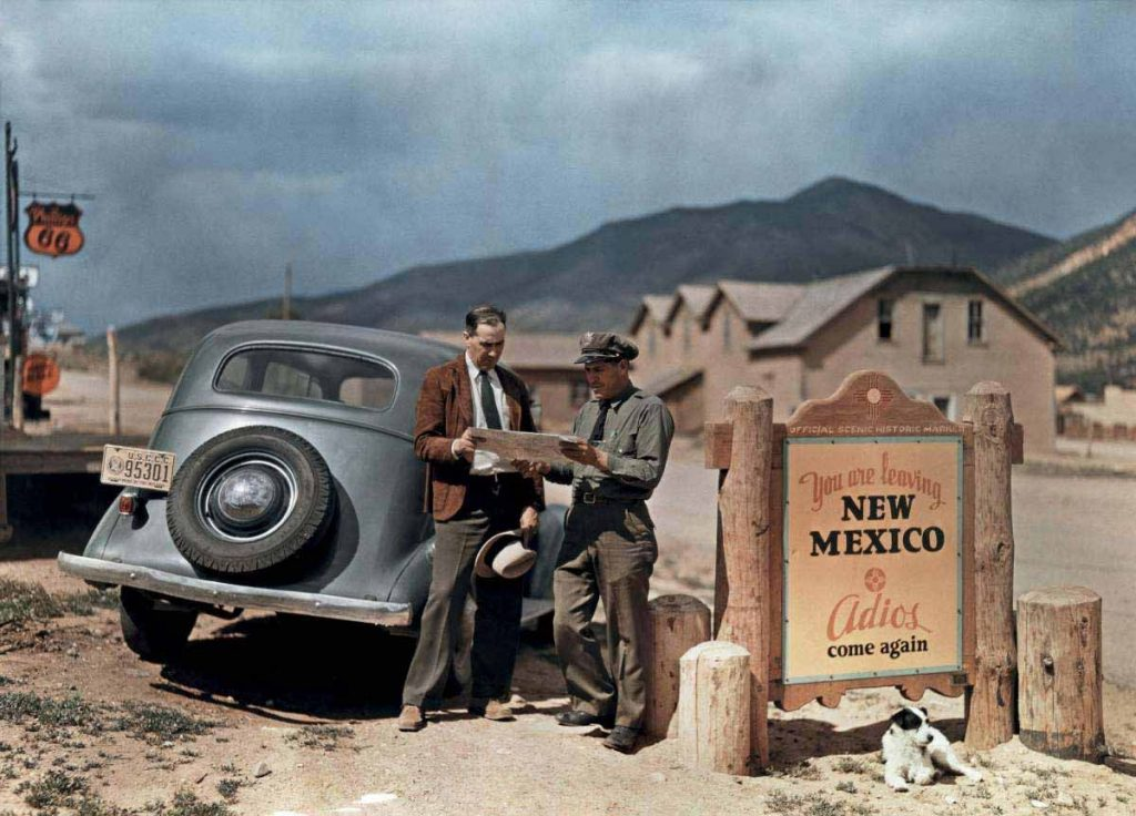 A motorist stops to get directions from a state trooper in New Mexico, 1939