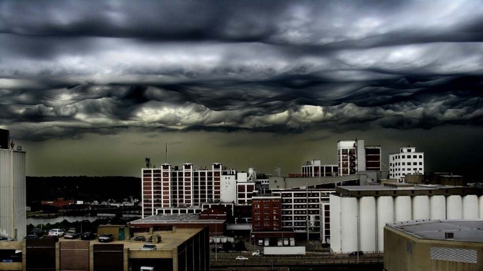 Terrifying storm clouds forming over a city