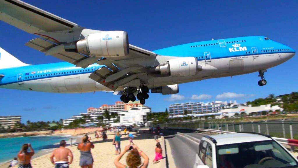 An airplane coming in for a landing at St. Maarten airport