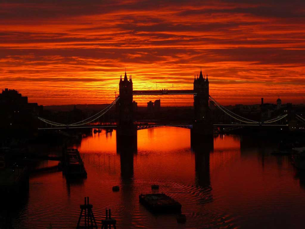 sunrise over london's tower bridge