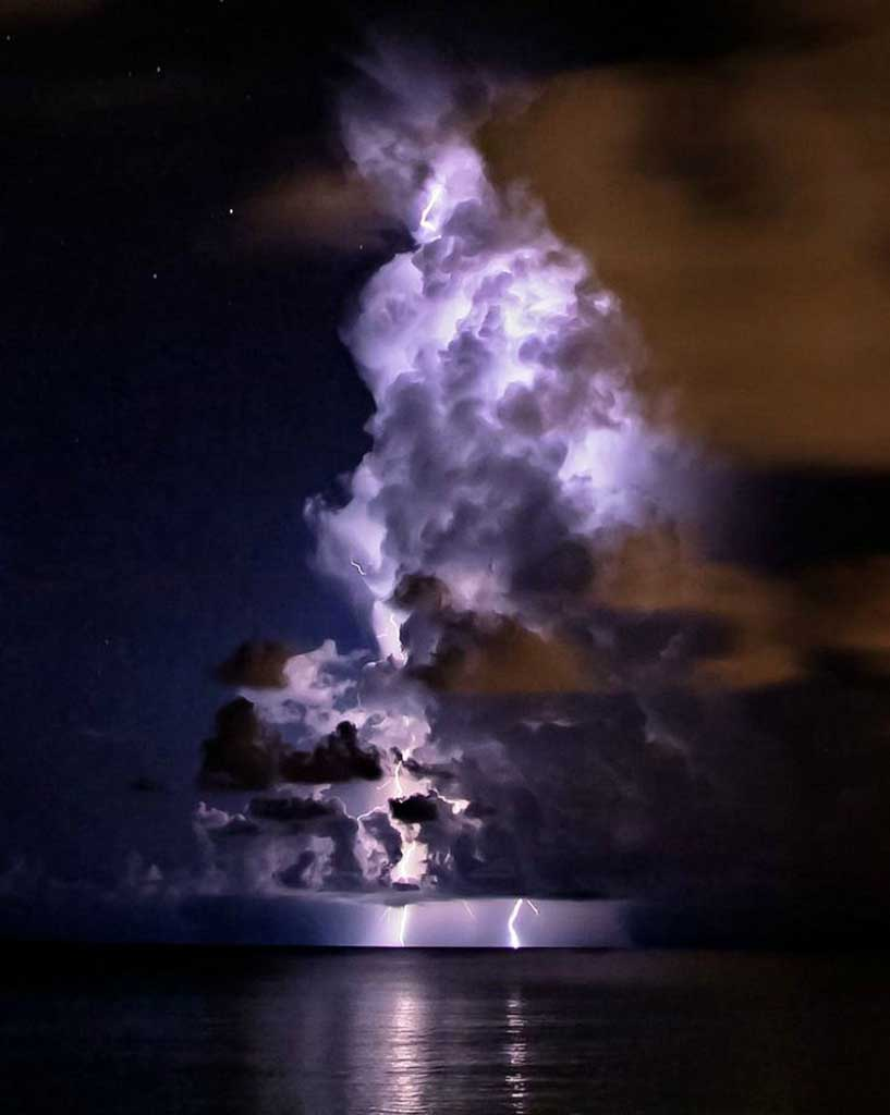 a cloud illuminated by lightning