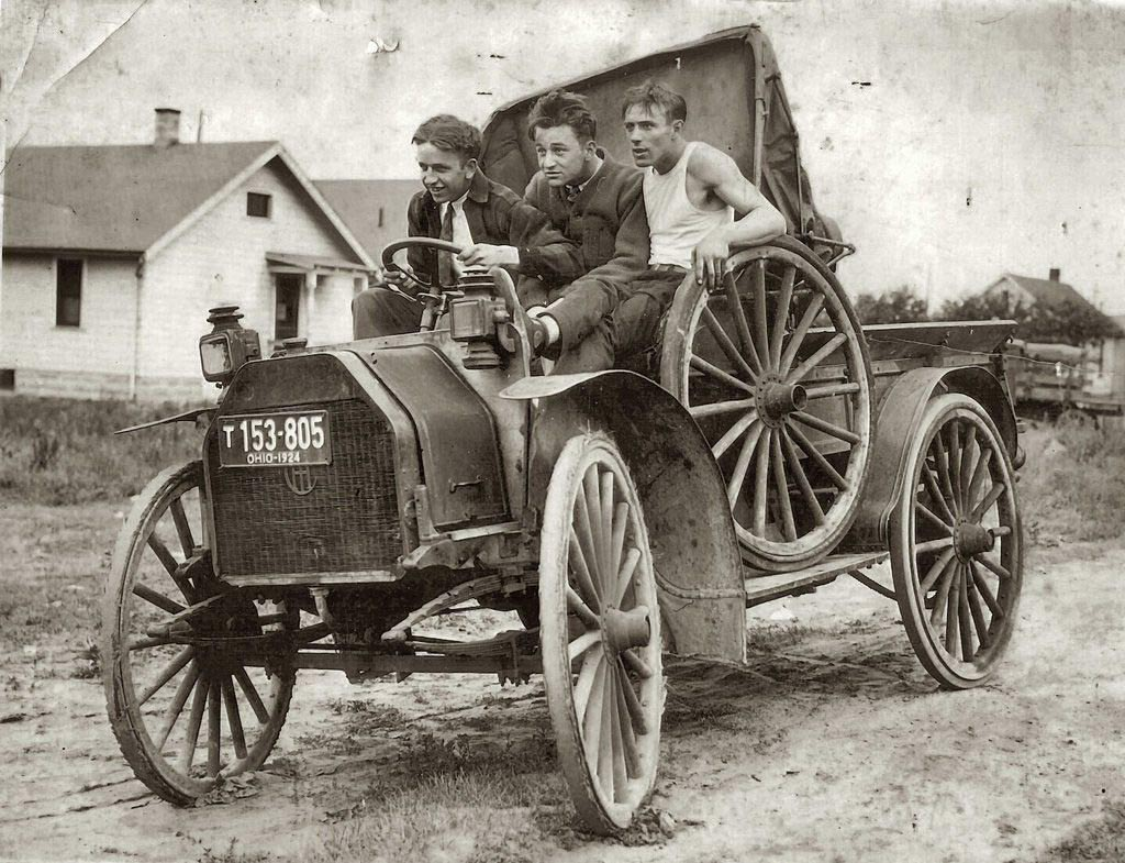 Three young men in a vehicle, c. 1924