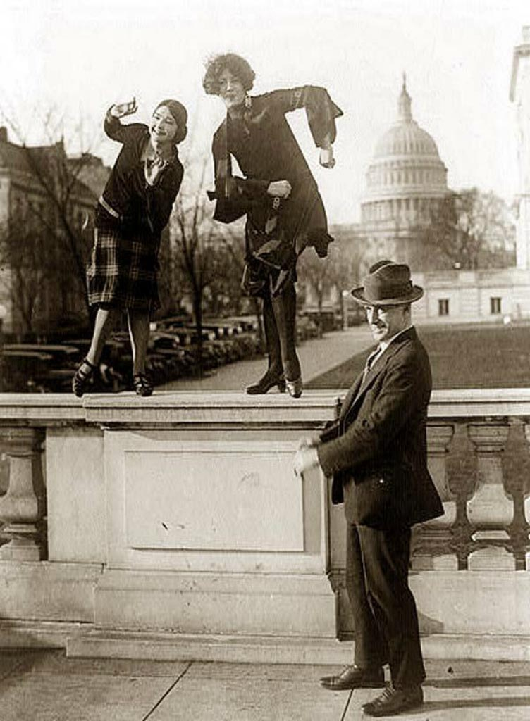 Dancing the Charleston on a railing in front of the US Capitol